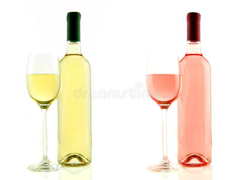Бутылка и стекло белого и изолированного розового вина стоковое фото