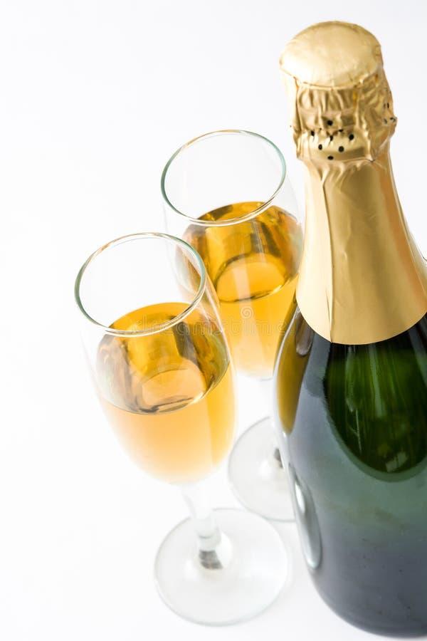 Бутылка Шампани и кристаллические стекла стоковая фотография rf