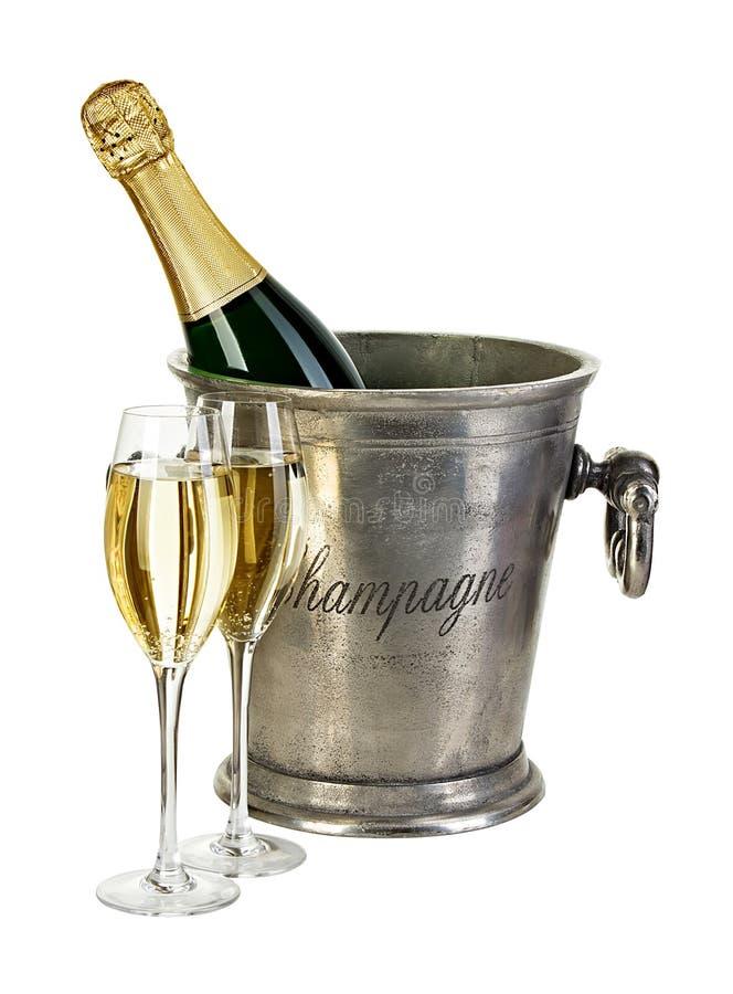 Бутылка шампанского в ведре льда стоковые фото