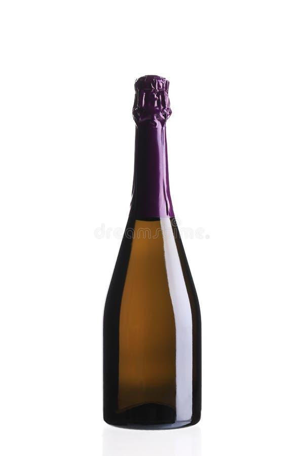 Бутылка шампанского с фиолетовой верхней частью стоковые фотографии rf