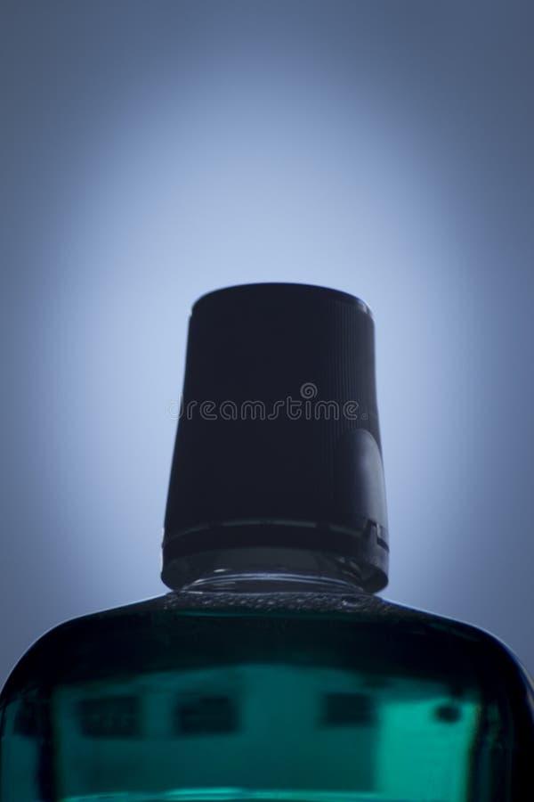 Бутылка mouthwash мяты зубоврачебного стоковое фото