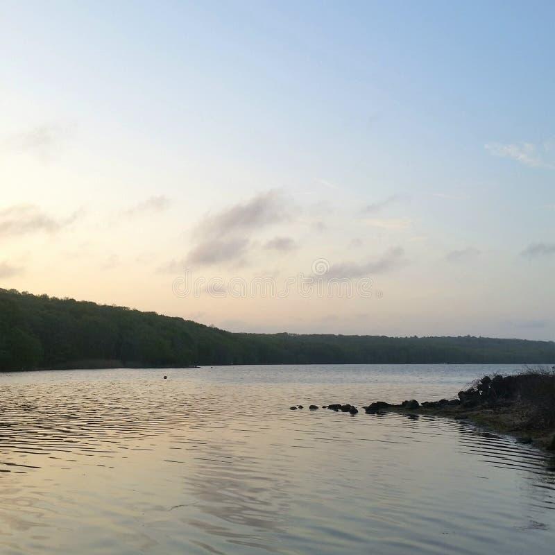 Бухта захода солнца стоковое фото rf