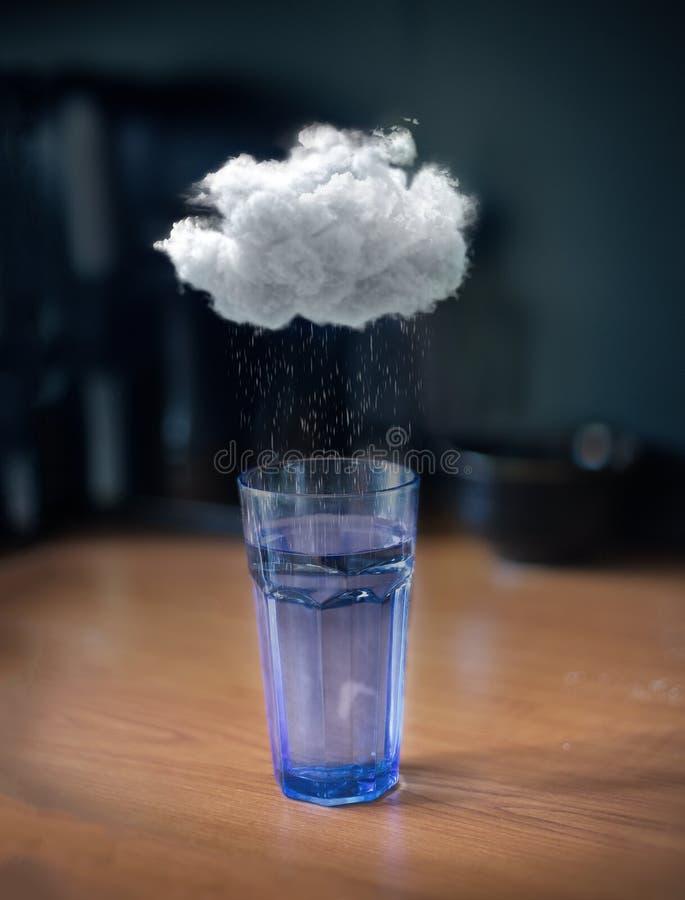 Бушуйте в стекле воды стоковые изображения