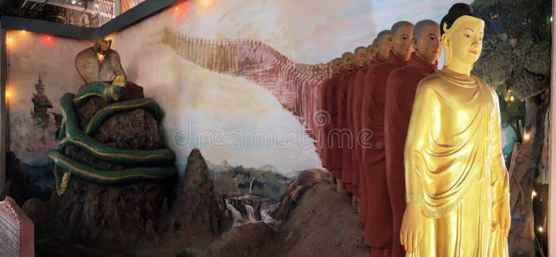 Будда с учениками, висок пагоды Ngahtatkyi стоковая фотография