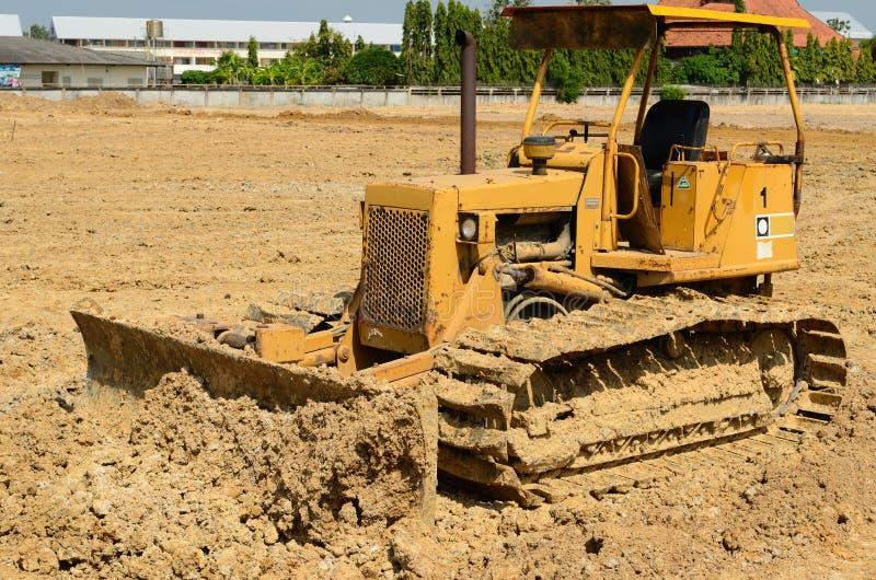 Download Бульдозер грейдера дороги на месте Стоковое Изображение - изображение насчитывающей пряжек, актиния: 41659885