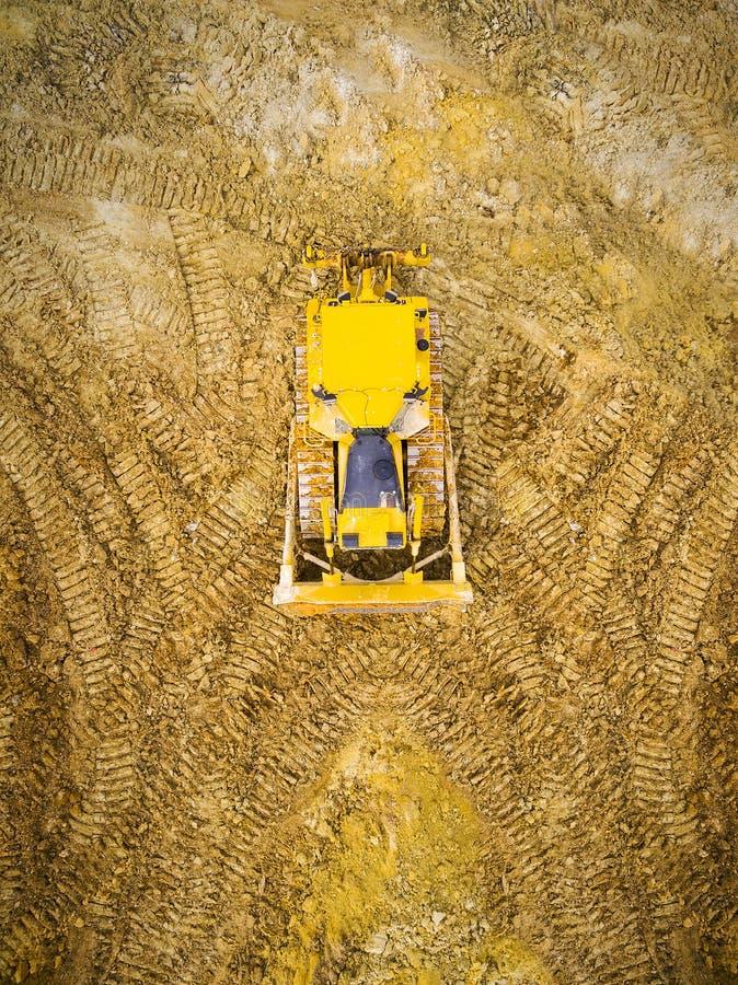 Бульдозер на тинной местности стоковое изображение rf
