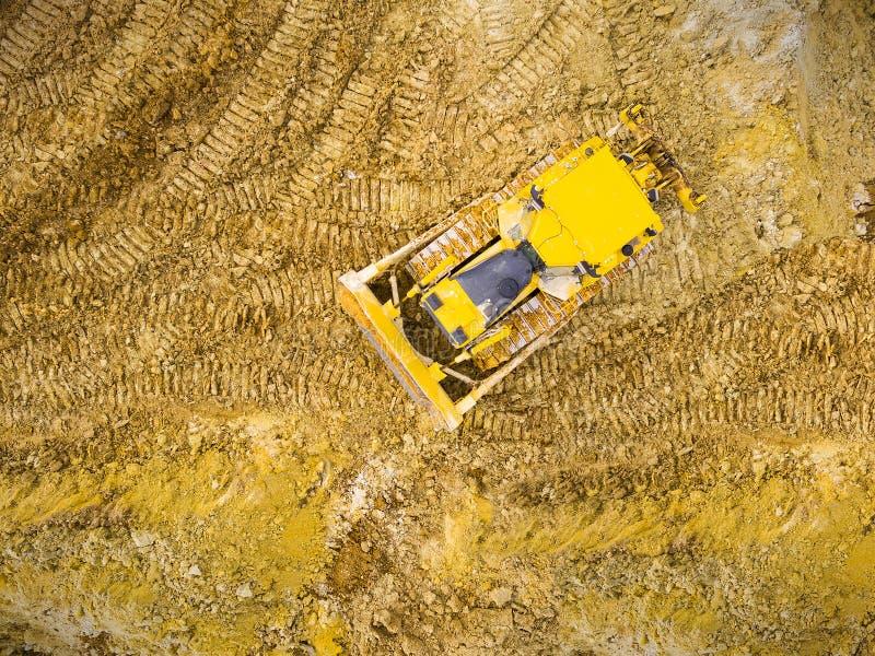 Бульдозер на тинной местности стоковая фотография