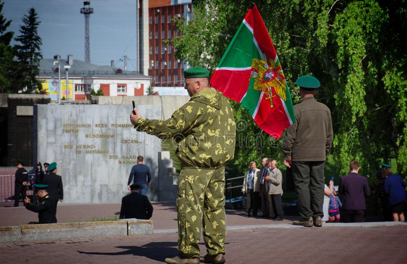 Бывшие солдаты празднуя день пограничника стоковые изображения