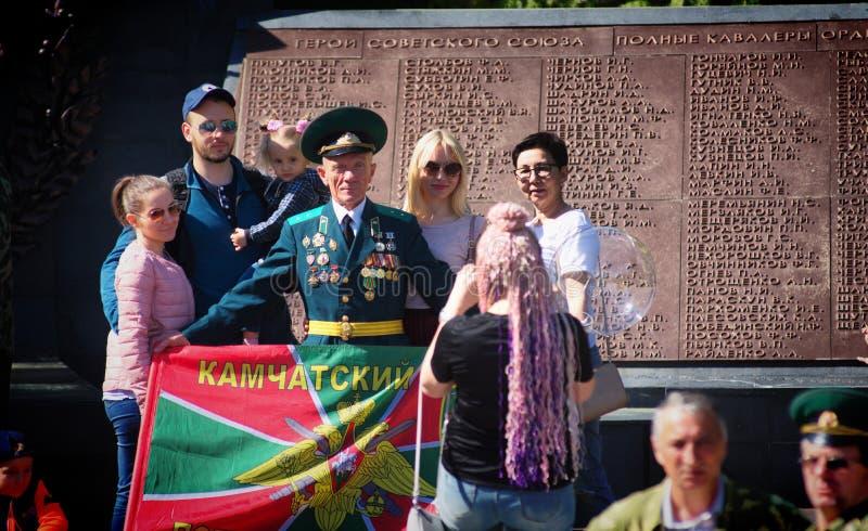 Бывшие солдаты празднуя день пограничника стоковые фото