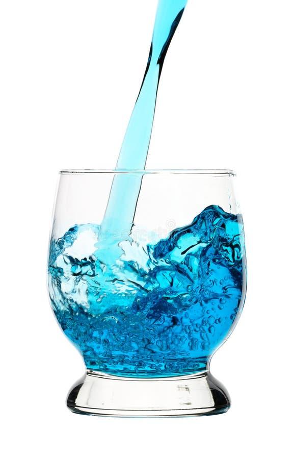был голубым политым стеклом питья стоковое фото rf