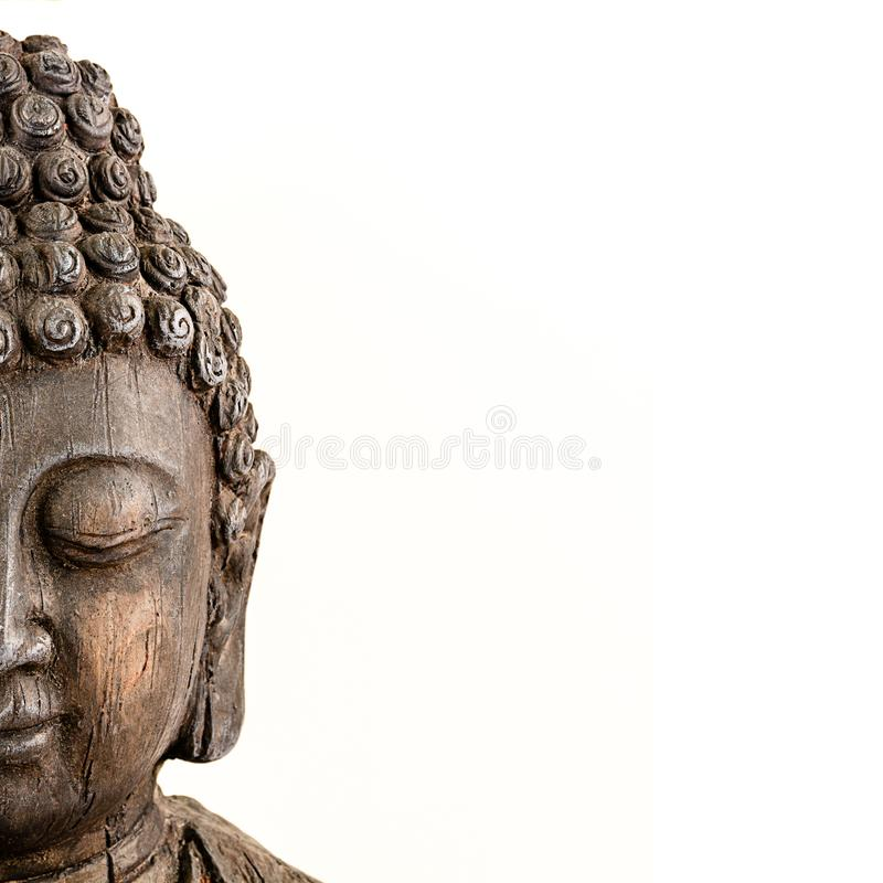 Бюст Будды на белой предпосылке стоковое изображение rf