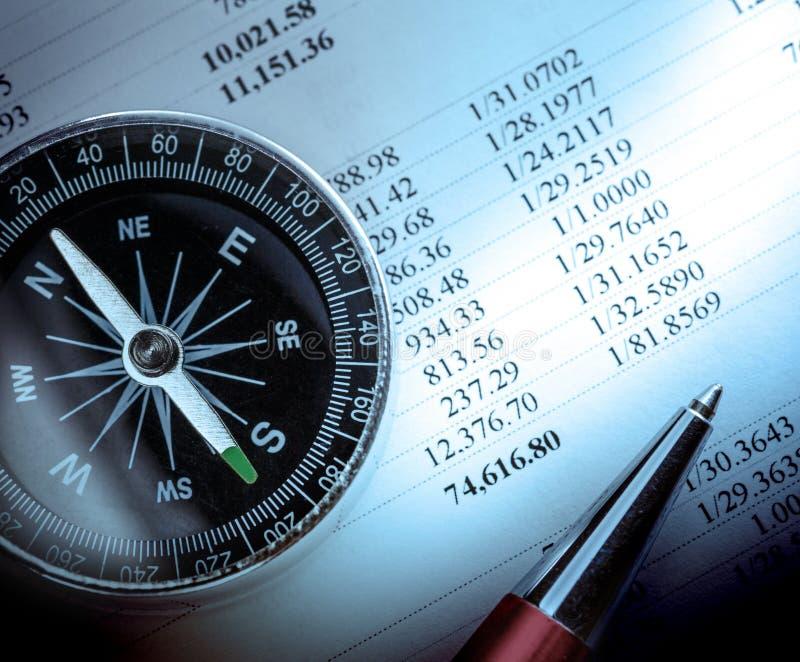 Бюджет, компас и ручка стоковые фотографии rf