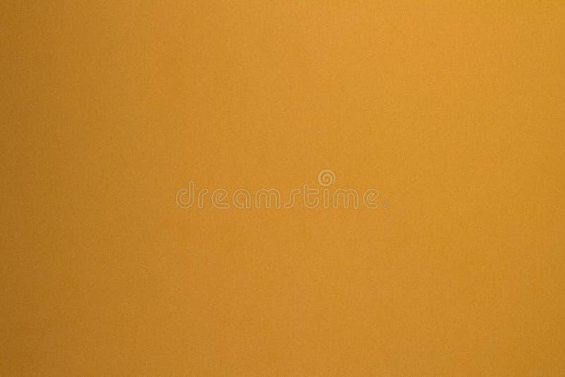 Бледный градиент пожелтел оранжевую предпосылку текстуры стены штукатурки стоковое изображение rf