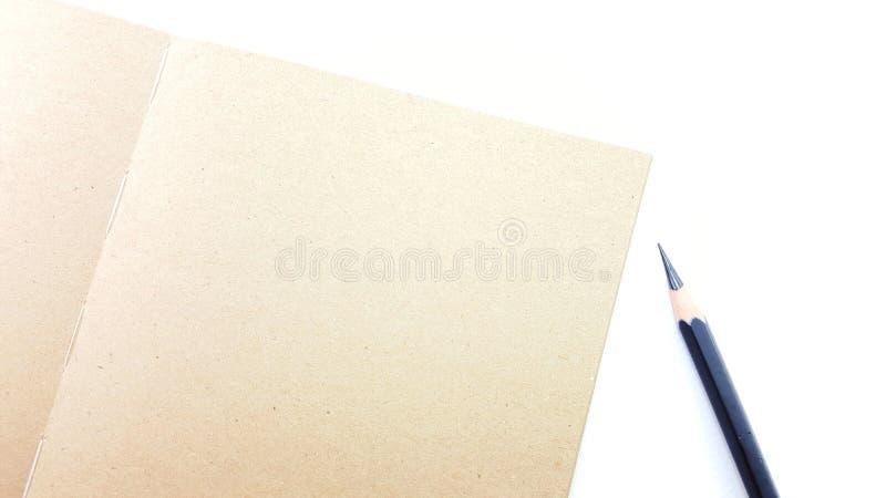 Блокнот с карандашем и космос для пишут стоковое фото rf