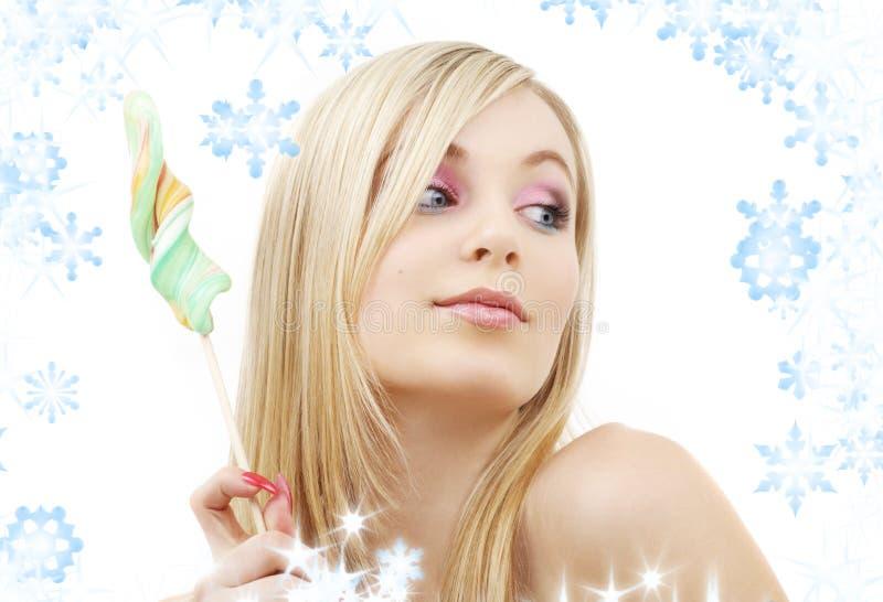 Блондинка леденца на палочке стоковые изображения