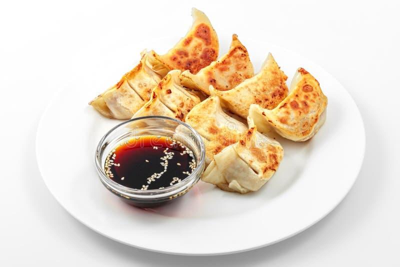 Блюдо gedza Ebi горячее, соевый соус, японец зажарило вареники стоковые изображения rf