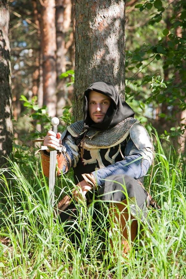 вал рыцаря сидя вниз стоковые фотографии rf