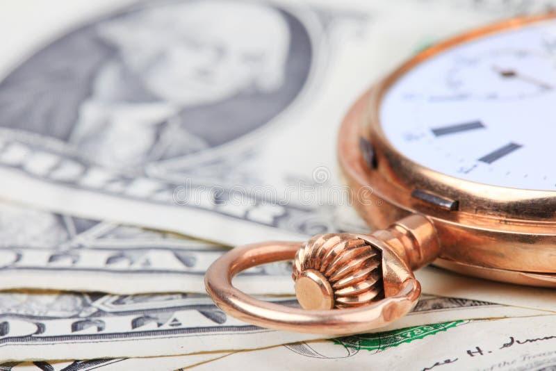 Вахта золота на банкнотах денег доллара Селективный фокус стоковые фотографии rf