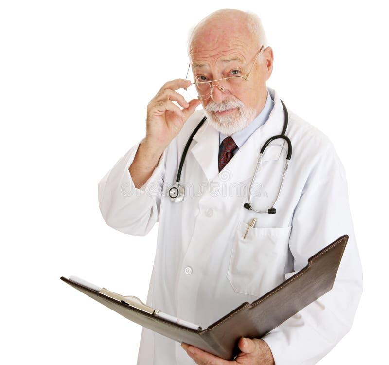 ваше здоровья доктора серьезное стоковая фотография rf