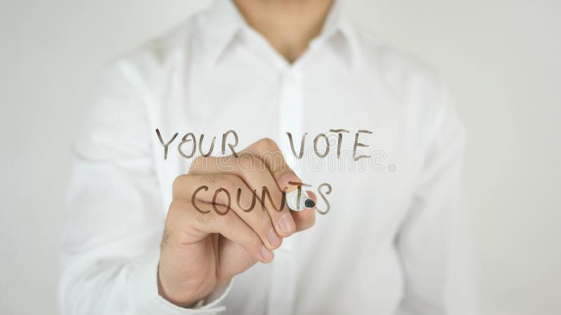 Ваши отсчеты голосования, написанные на стекле стоковая фотография