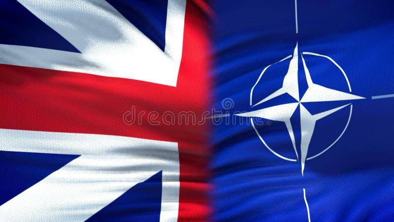 Великобритания и предпосылка флагов НАТО, дипломатический и экономические отношения стоковые изображения rf