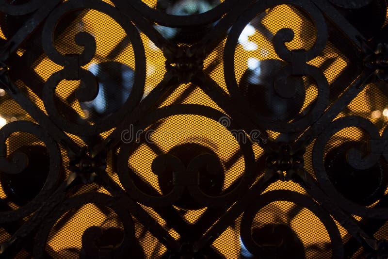Вензеля стены черного листового железа стоковое фото