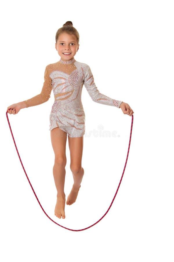 Веревочка девушки скача прыгая стоковые изображения