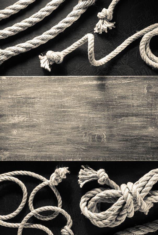 Веревочка корабля на черноте стоковая фотография