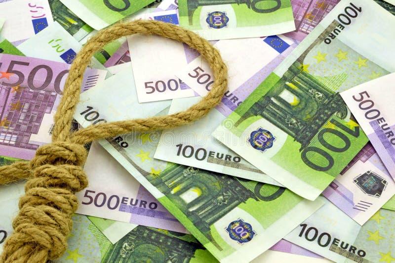 Веревочка на предпосылке денег стоковые фото