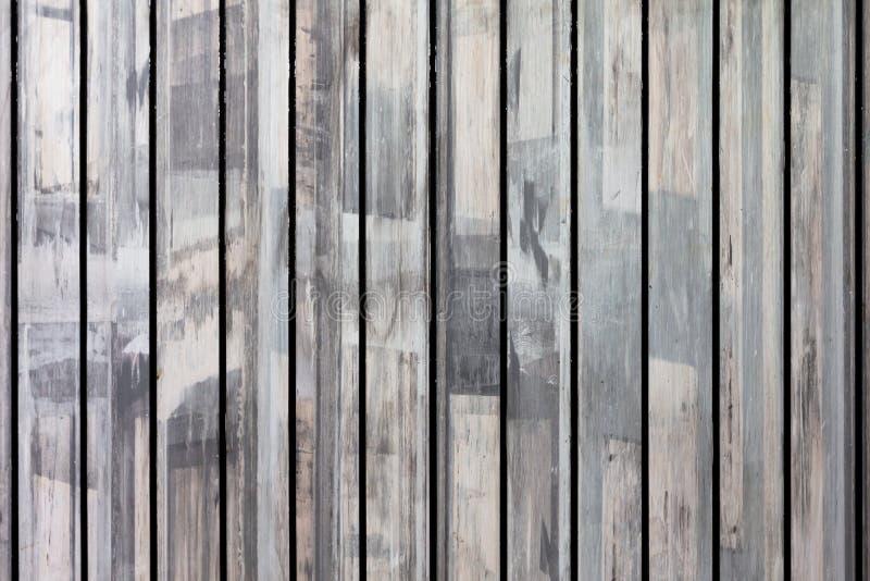 Вертикальная линия старая деревянная предпосылка панели и текстуры стоковые фото