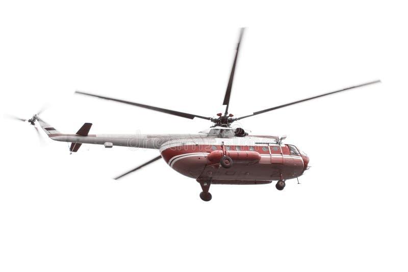 Вертолет при красный фюзеляж изолированный на белой предпосылке стоковые изображения rf