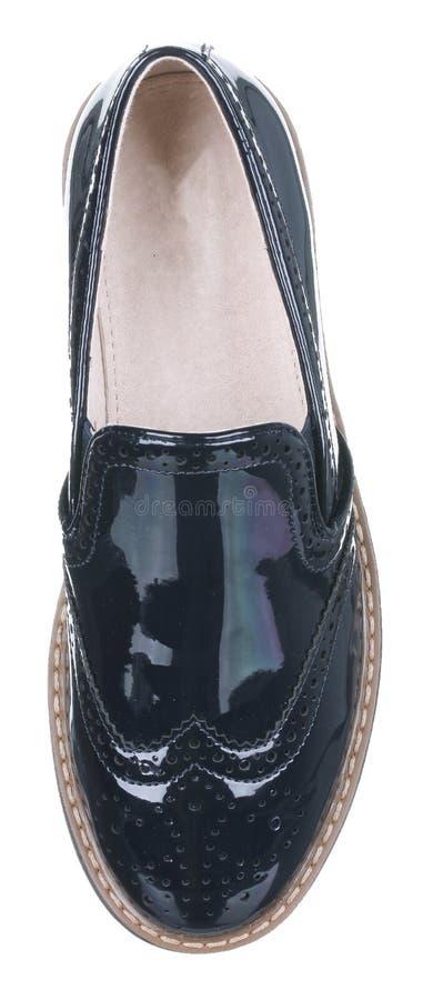 Верхний взгляд черноты и коричневого цвета залакировал кожаный мужской ботинок лета стоковое фото