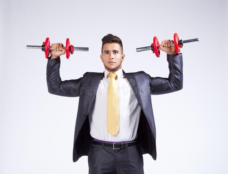 весы бизнесмена поднимаясь стоковая фотография