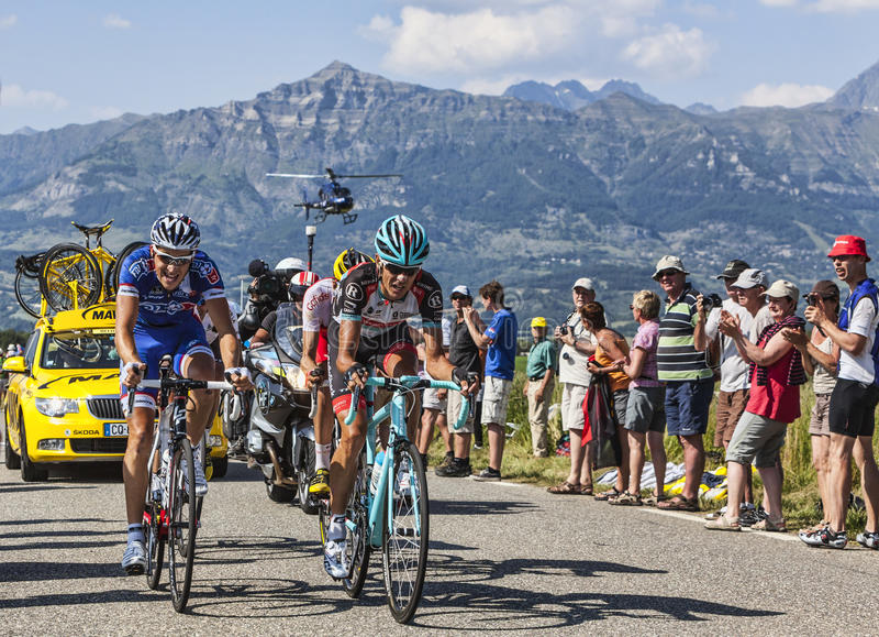 Велосипедисты Andreas Kloden и Арнольд Jeannesson стоковые фотографии rf