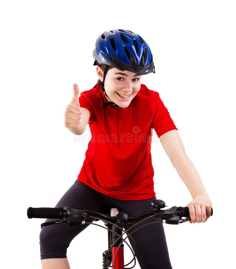 Велосипедист показывая ОДОБРЕННЫЙ знак изолированный на белой предпосылке стоковое фото rf