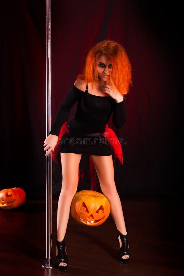 Ведьма красного цвета Photoshoot стоковое фото rf