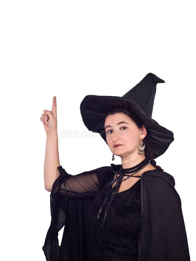 Ведьма хеллоуина указывает вверх стоковые фото