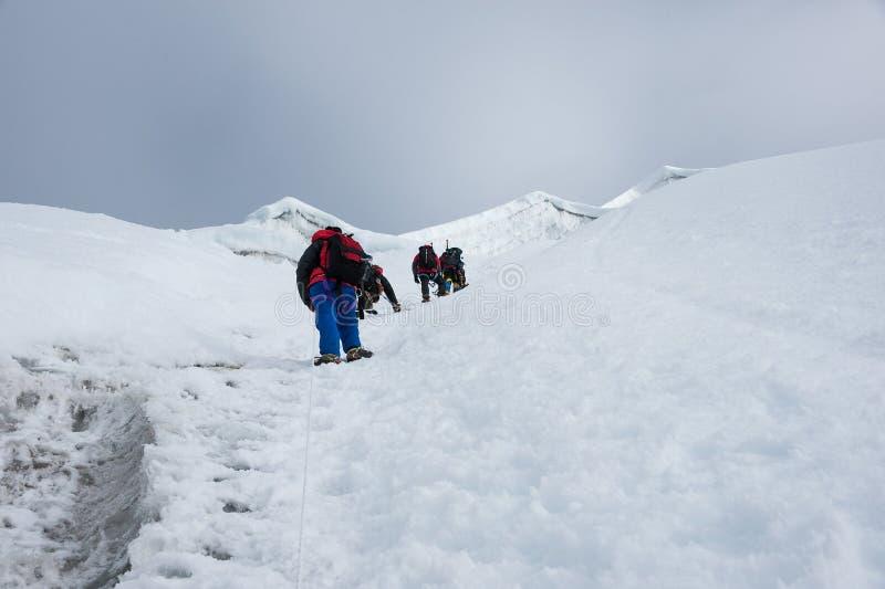 Взбираться Lobuche восточный пиковый, зона Эвереста, Непал стоковая фотография rf