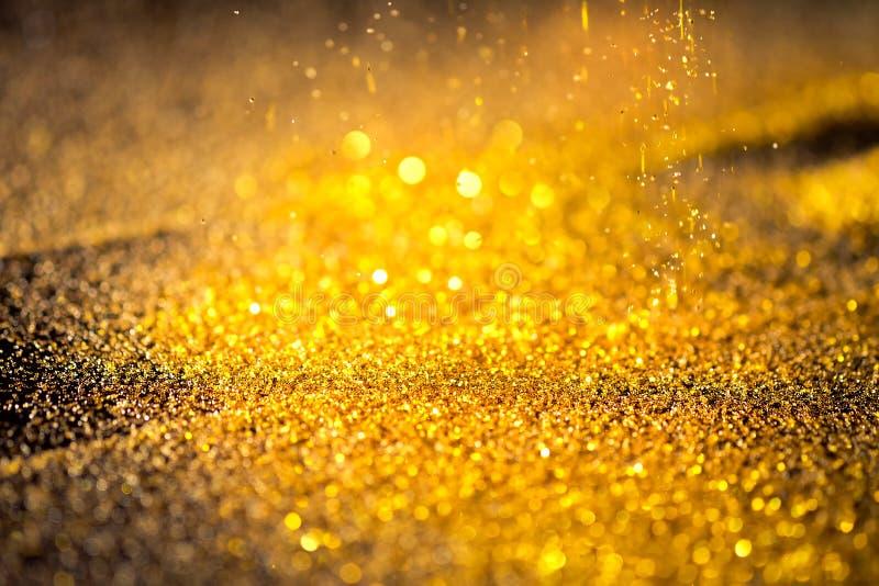 Взбрызните пыль золота сияющую стоковые фото