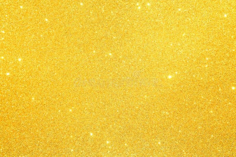 Взбрызните текстурированный золотой песок яркого блеска стоковая фотография