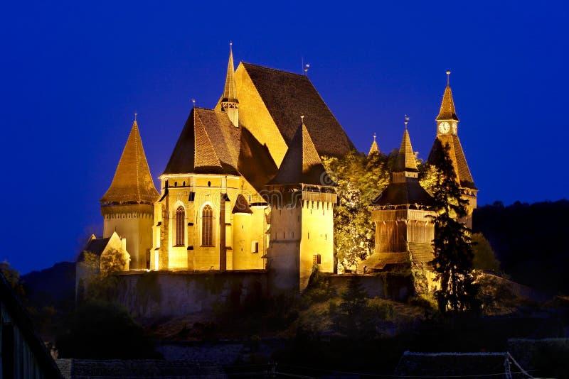 Взгляд ночи церков укрепленной Biertan стоковая фотография rf