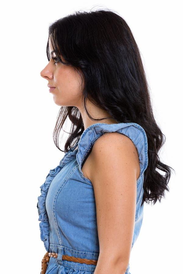 Взгляд профиля молодой красивой испанской женщины стоковое изображение rf