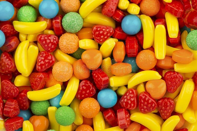 Взгляд сверху на текстуре предпосылки красочных трудных конфет стоковые изображения
