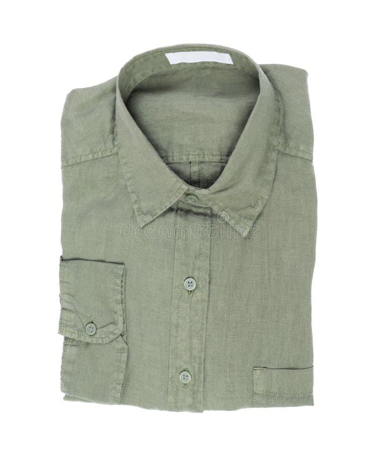 Взгляд сверху, новая ультрамодная зеленая рубашка белья изолированная на белой предпосылке стоковая фотография rf