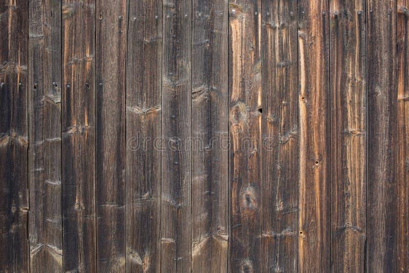 Взгляд сверху темной задней части конспекта текстуры Брайна естественной деревенской деревянной стоковые фотографии rf