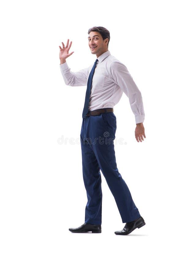 Взгляд со стороны бизнесмена идя стоящий изолированный на белом backgro стоковое изображение rf