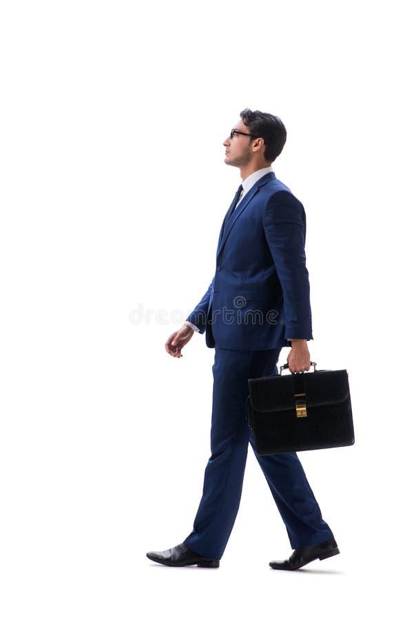Взгляд со стороны бизнесмена идя стоящий изолированный на белом backgro стоковые изображения rf