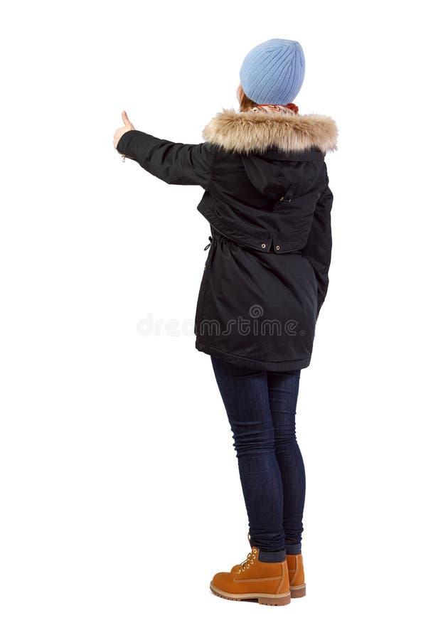Взгляд со стороны женщины в больших пальцах руки parka вверх стоковая фотография