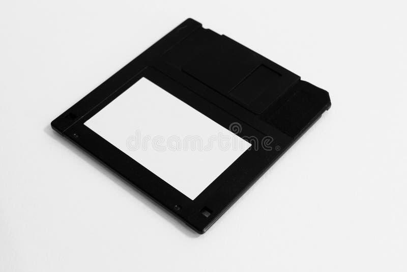 Взгляд со стороны пластиковой дискеты с пустым ярлыком стоковое изображение