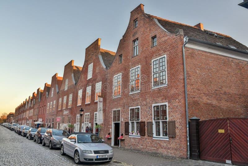 Взгляд улицы в голландском квартальном районе Hollandisches Viertel Потсдама, Германии стоковые фото